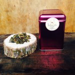This photo displays our 100 gram Loose Leaf, Maple Green Tea tin.